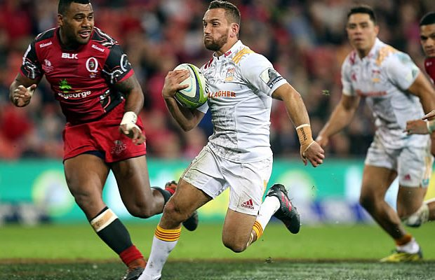 Aaron Cruden on the run for the Chiefs against the Reds