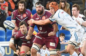 Exeter's player Ollie Atkins (R) tackles Bordeaux's Adam Jaulhac (C)