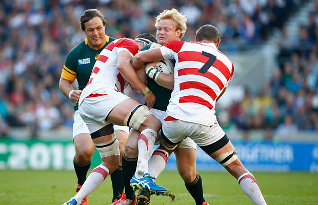 Adriaan Strauss gets wrapped up by the Japanese defence