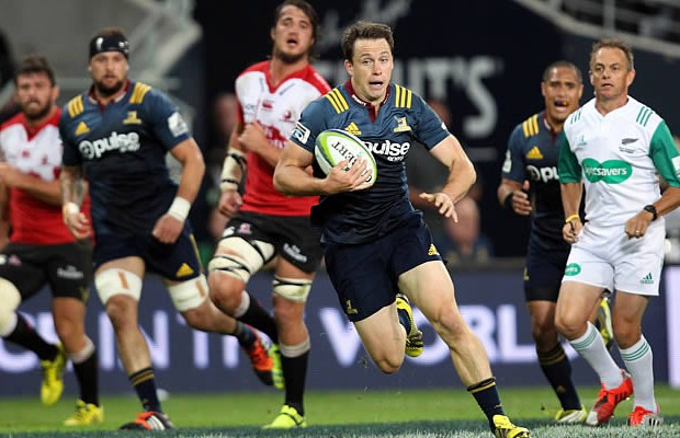 Ben Smith of the Highlanders attempts to break the Lions