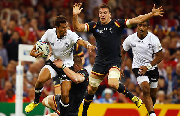Ben Volavola is tackled by the Wales defence