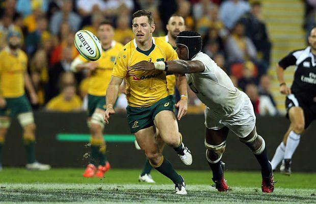 Bernard Foley is tackled by Maro Itoje