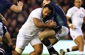 Billy Vunipola runs into Matt Scott