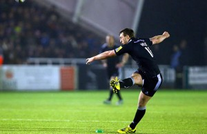 Craig Willis kicks a penalty goal for Newcastle Falcons