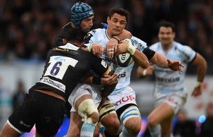 Dan Carter is tackled by Courtney Lawes and Michael Paterson