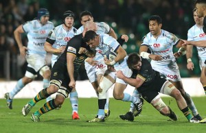 Dan Carter gets double tackled by Northampton Saints