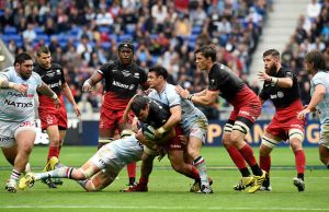 Dan Carter tackles Schalk Brits of Saracens