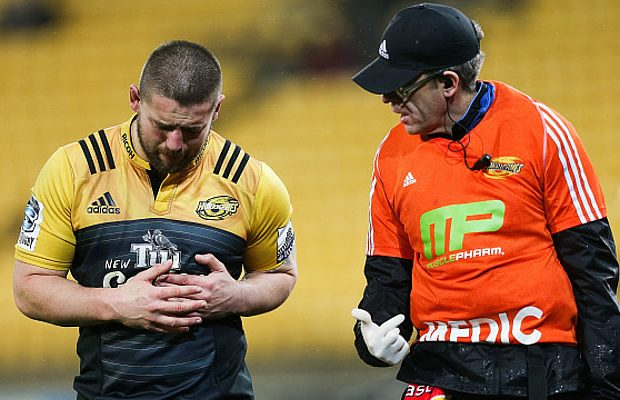 Dane Coles holds his rib cage in pain in the quarter finals