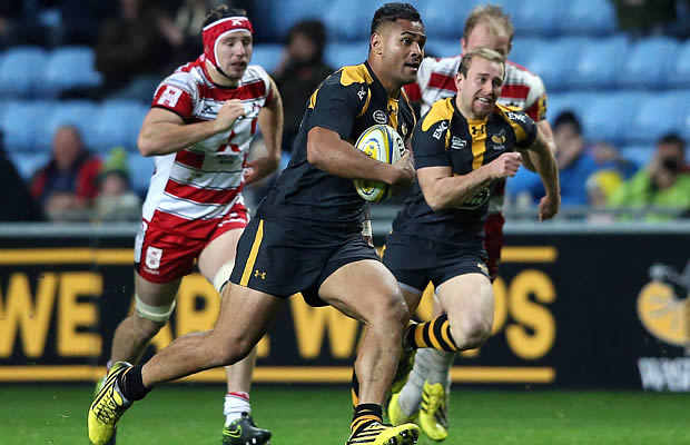 Frank Halai of Wasps breaks with the ball