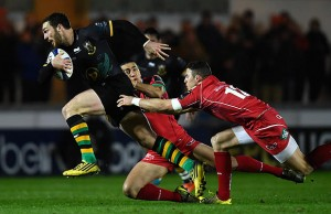 George North breaks through the defence of his former team