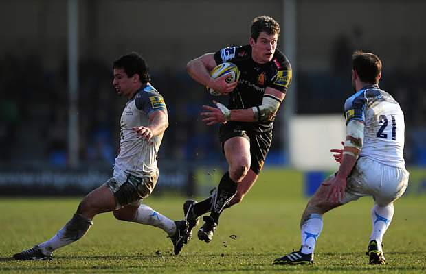 Ian Whitten is tackled by the Falcons defence