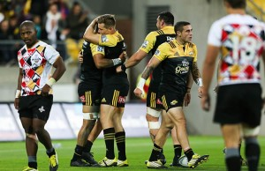 Jason Woodward celebrates with Ardie Savea