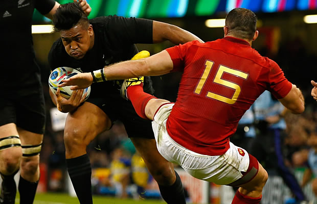 All Black winger Julian Savea powers past France fullback Scott Spedding