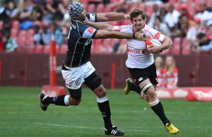 Marco Wentzel tackles Kwagga Smith