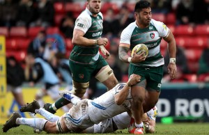 Manu Tuilagi of Leicester is held by Olliie Atkins