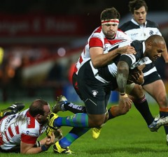 Nemani Nadolo is tackled by Gloucester's defence