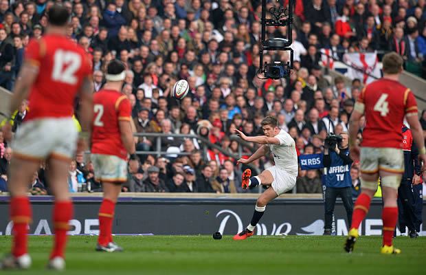 Owen Farrell kicks a penalty for England
