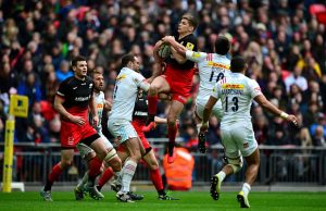 Owen Farrell jumps for the ball