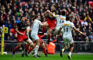 Owen Farrell jumps for the ball