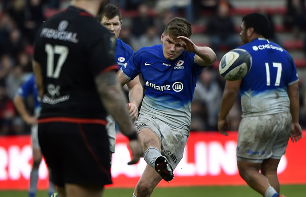 Owen Farrell clears the ball for Saracen