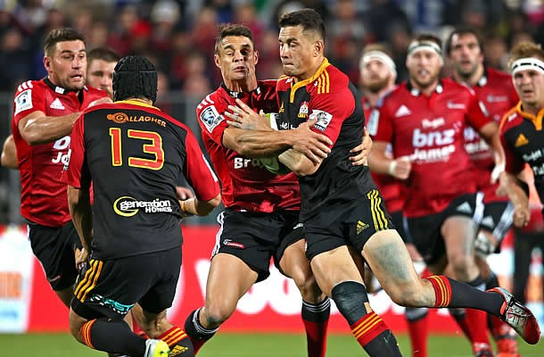 Sonny-Bill Williams is tackled by Dan Carter in the last Chiefs v Crusaders match