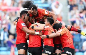 The Sunwolves celebrate victory over the Jaguares