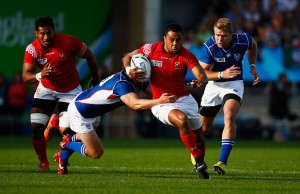 Telusa Veainu of Tonga runs at the Namibian defence