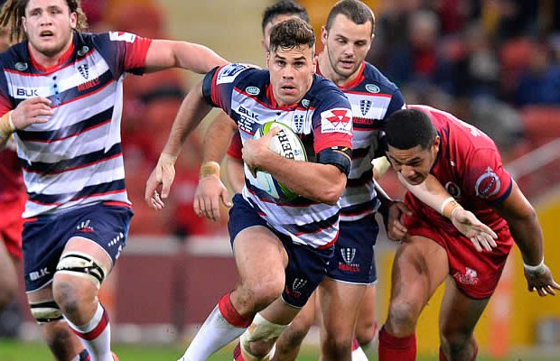 Try scorer Tom English on the run for the Melbourne Rebels