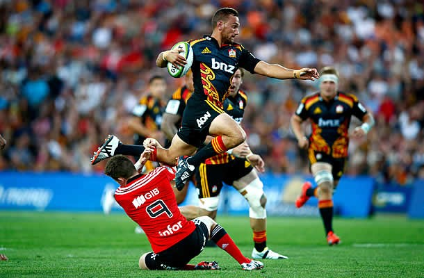 Aaron Cruden avoids a tackle while Sam Cane runs behind in support