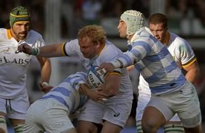 Springbok hooker Adriaan Strauss defends the ball