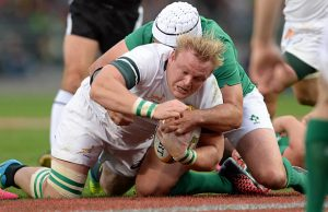 Adriaan Strauss defends the ball for South Africa