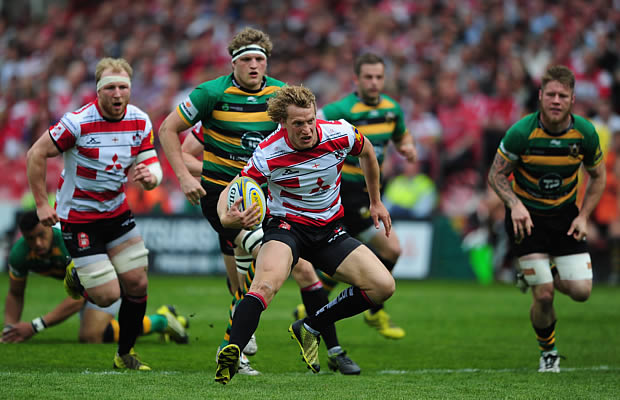 Billy Twelvetrees tries to evade the Northampton defence