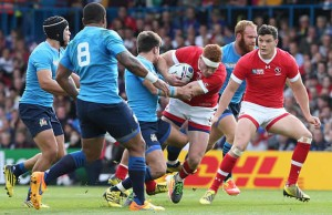 Connor Baird of Canada tries to break away