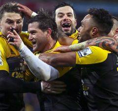 Corey Jane celebrates with his Hurricanes team mates