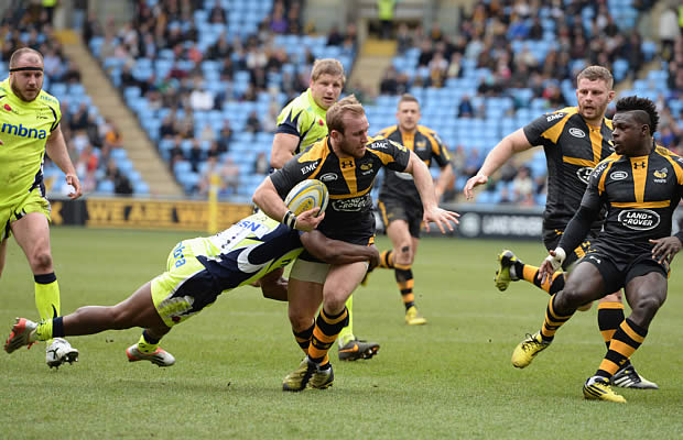 Dan Robson of Wasps is tackled by Neville Edwards of Sale Sharks