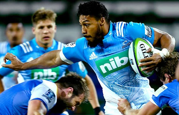 George Moala of the Blues attempts to break from a tackle
