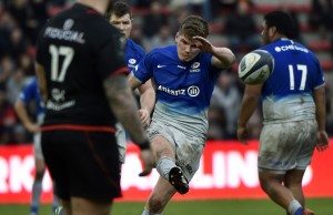 Owen Farrell kicks for goal for Saracens