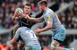 Henry Slade defends the ball for Exeter