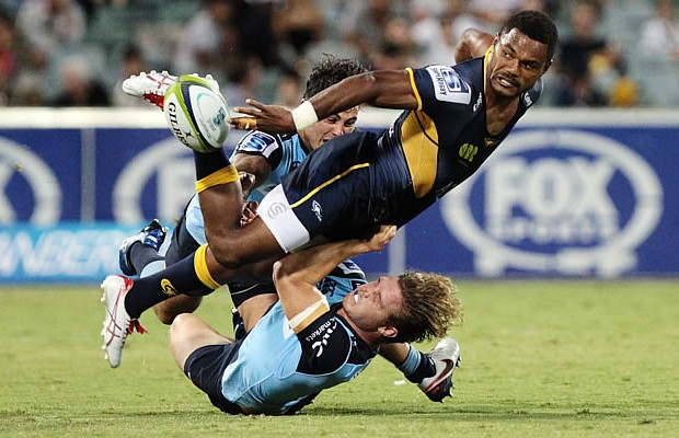 Henry Speight gets the ball away in a tackle