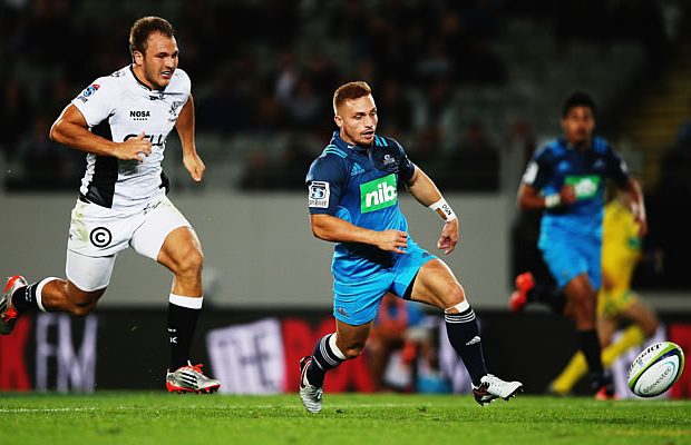 Ihaia West chases the ball for the Blues