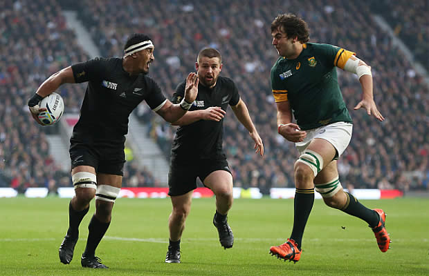 Jerome Kaino fends off a tackle on his way to the tryline
