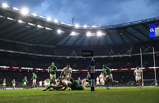 Jonathan Joseph is tackled short of the line for England