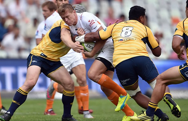 Joubert Engelbrecht is double tackled by the Brumbies