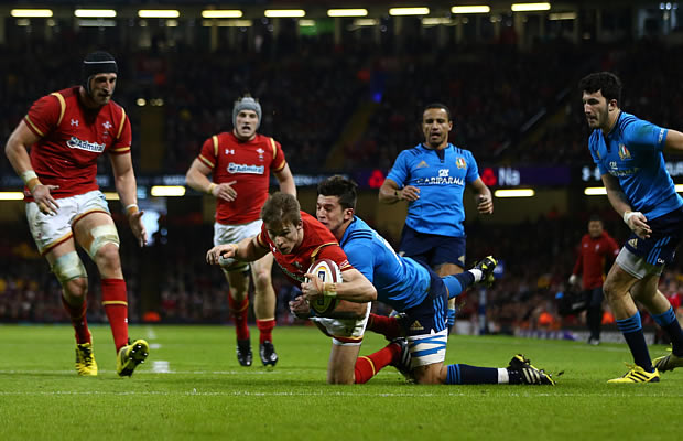 Liam Williams gets brought to ground by the Italian defence