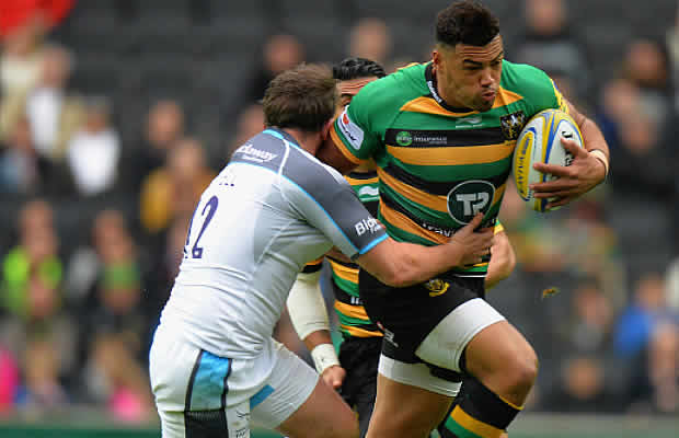 Luther Burrell fends off a tackle for Northampton Saints