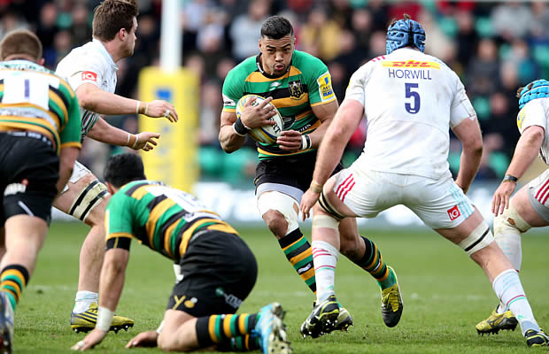 Luther Burrell looks to break through the Harlequins defence