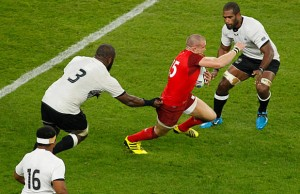 England's Mike Brown on the break against Fiji
