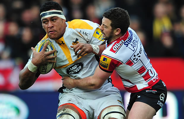 Nathan Hughes defends the ball for Wasps