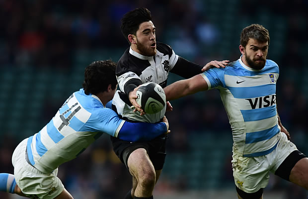 Rugby World cup winner Nehe Milner-Skudder gets closed down by the Pumas defence