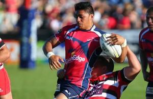 Pete Samu of Tasman is tackled